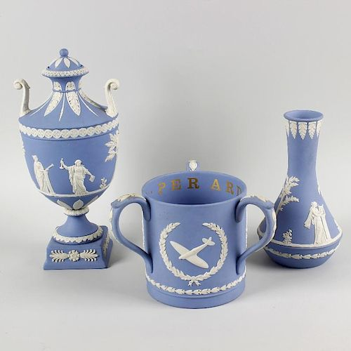 A box containing a Wedgwood blue jasperware twin handled pedestal vase and cover decorated with clas
