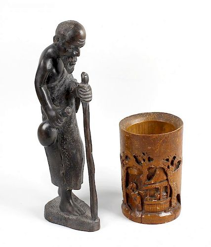 A box containing assorted collectables To include: an Oriental carved brush pot, an African figure,