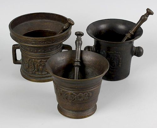 A box containing seven assorted cast mortars with pestles. The largest in 15th century style with ps