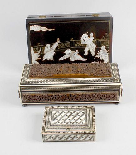 A box containing a mixed selection of Eastern boxes. To include a black lacquered jewellery box deco