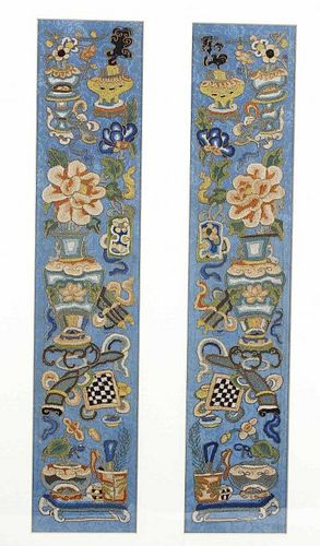 A pair of Chinese silk panels, of near symmetrical design, embroidered with vases of flowers, incens