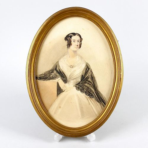 An early Victorian oval watercolour portrait of a lady.Depicted knee-length in three-quarter profile