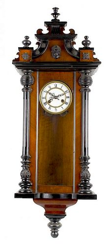 A walnut and ebonised spring-driven Vienna wall clock With white Roman dial and two-train movement w