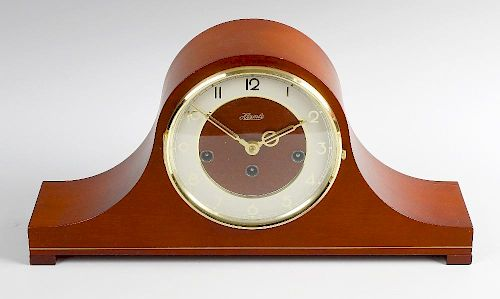 A modern Hermle 'Napoleon's hat' chiming mantel clock. The cream Arabic chapter ring, within mahogan