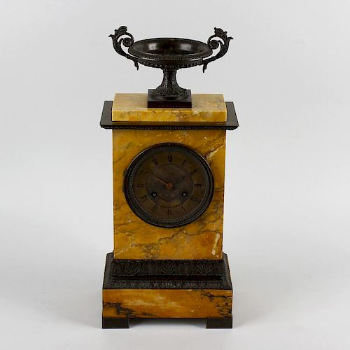 An early to mid 19th century French bronze and sienna marble mantel clock.Pons, Paris.The 3.75-inch