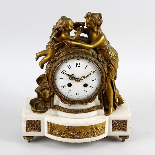 An early to mid 19th century French ormolu and white marble mantel clock.Samuel Marti, Paris.Having