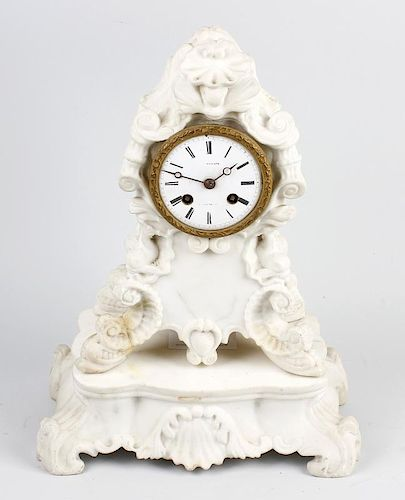 A French white marble clock and stand The 3.25-inch white Roman dial inscribed with Versailles retai