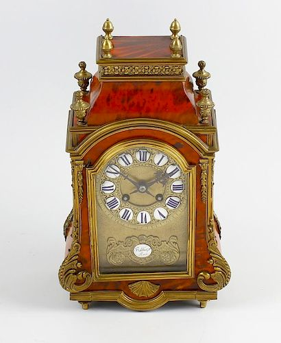A good 19th century French red tortoiseshell mantel clock The break-arched brass dial with enamel ca