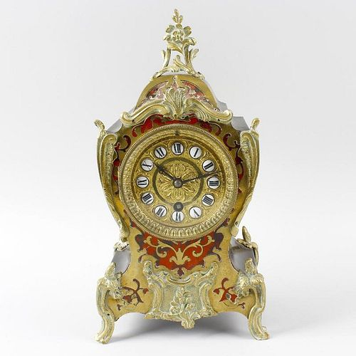 A late 19 century French red tortoiseshell and boulle mantel clock. The 3.25 inch circular dial with