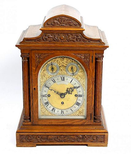 A good late 19th century oak-cased triple fusee bracket or table clock The 6.5-inch arched brass dia