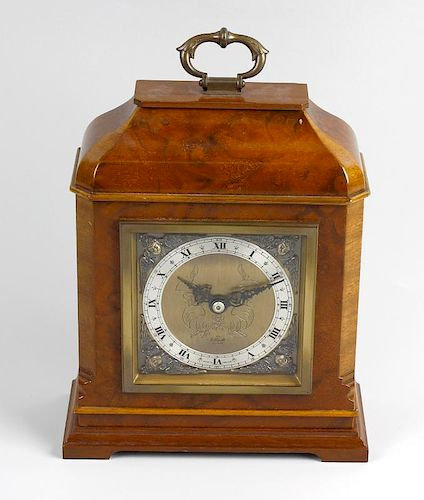 An Elliott walnut mantel clock The 3.5-inch square brass dial with silver chapter ring, having a bac