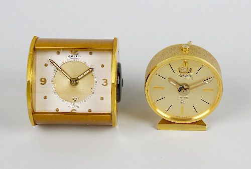Two Jaeger travel clocks. The first with rectangular dial having gilt circular chapter with Arabic q