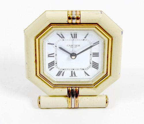 A Cartier desk clock. The octagonal white Roman dial marked CARTIER PARIS, within cushion-moulded su