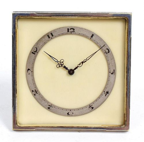 A Swiss Art Deco desk timepiece. The 3-inch Arabic chapter ring and blued steel hands upon a cream p