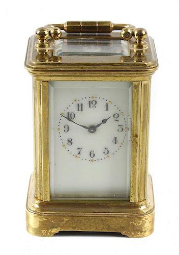 A miniature brass corniche case (mignonette) carriage clock, the cream enamelled Arabic dial with gi