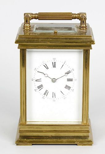 A late 19th century Anglaise-cased brass carriage clock The white dial with Roman hours, Arabic minu