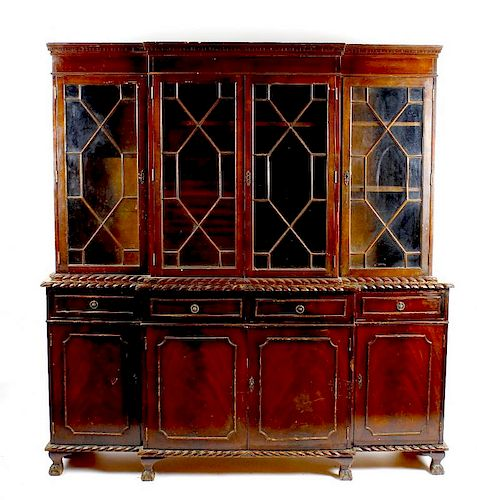 A mahogany reproduction breakfront bookcase cabinet The upper section with dentil cornice over two p