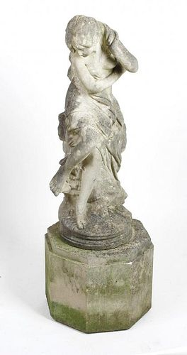 A composition garden statue. Modelled as a classical-style odalisque or maiden, 33, (84cm) high, on