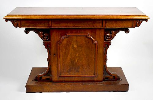 A mid 19th century mahogany serving table Possibly Scottish, the rectangular top with broad cavetto-