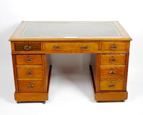A late Victorian walnut pedestal desk with dated provenance The later gilt-tooled green skiver with