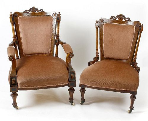 A late Victorian carved and inlaid walnut framed armchair, the pink upholstered back, above an overs