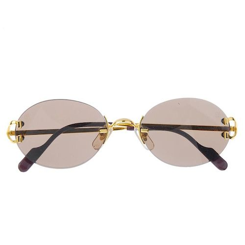 3882693e87 CARTIER - a pair of rimless sunglasses. Featuring oval shaped brown ...