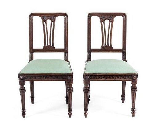A Pair of Neoclassical Walnut Side Chairs Height 36 3/4 inches.