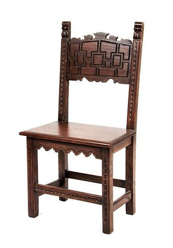 A Jacobean Style Walnut Hall Chair Height 40 1/4 inches.