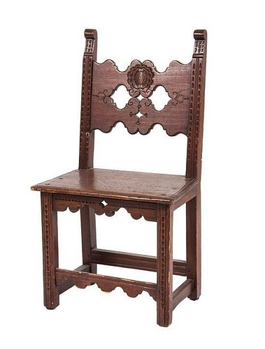 A Jacobean Style Walnut Hall Chair Height 37 3/4 inches.