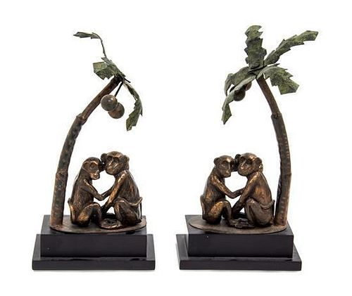 A Pair of Cast Metal and Tole Table Ornaments Height 11 1/2 inches.