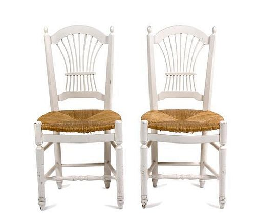 A Pair of White Painted Side Chairs Height 15 x width 15 x depth 35 1/2 inches.