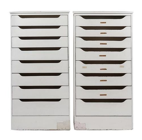 A Pair of White Painted Banks of Drawers Height 60 1/2 x width 31 x depth 12 inches.
