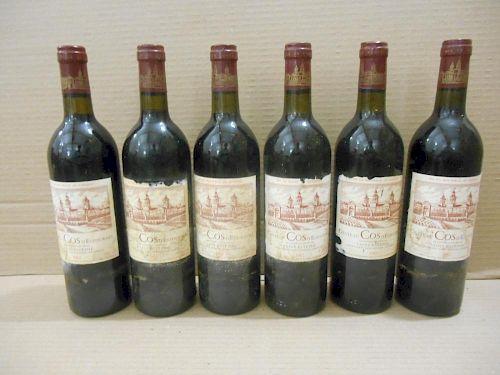 Chateau Cos D'Estournel, St Estephe 2eme Cru 1982, twelve bottles in damp-damaged owc (slightly dama