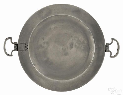 New York pewter warming dish, ca. 1775, bearing the touch of Henry Will, 9 1/2'' dia.