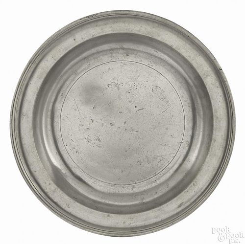 New York pewter deep dish, ca. 1780, bearing the touch of Frederick Bassett, 16 3/8'' dia.