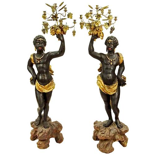 Pair of 19th C Italian Carved Painted and Gilt Wood and gilt tole Blackamoor torchieres. Unsigned. Rubbing, minor surface cracks, losses otherwise goo