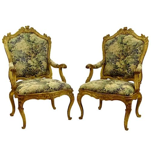 Large pair of 19th Century Italian carved and gilt wood fauteuils with modern tapestry upholstery. Unsigned. Rubbing, surface wear, repairs, overall g