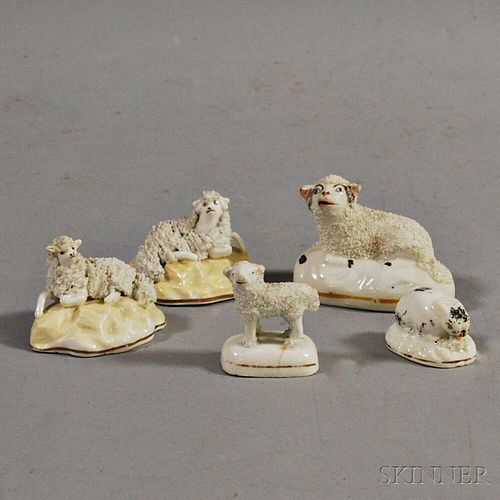 Four Porcelain Lambs and a Bunny Figurine Group