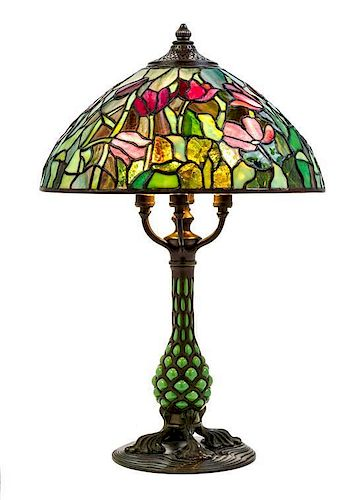 A Tiffany Studios Favrile Glass And Bronze Blown-Out Glass Tulip Lamp, Height overall 24 1/4 x diameter of shade 16 inches.
