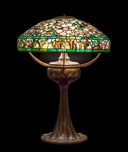 A Tiffany Studios Favrile Glass and Bronze Dogwood Lamp, Height overall 25 x diameter of shade 18 inches.