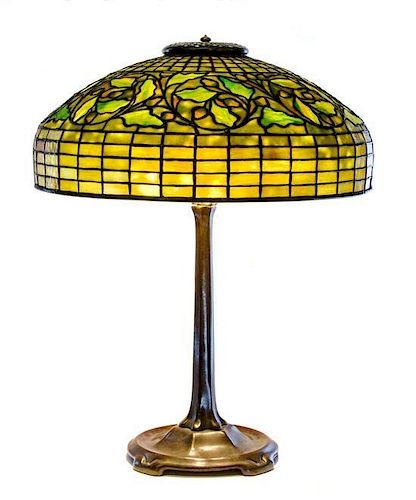 * A Tiffany Studios Favrile Glass and Bronze Swirling Oak Lamp, Height overall 22 1/2 x diameter of shade 18 inches.