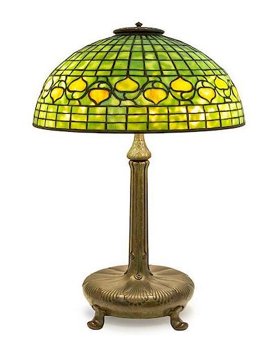 A Tiffany Studios Favrile Glass and Bronze Acorn Lamp, Height overall 23 x diameter of shade 16 inches.