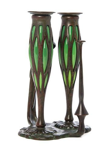 A Tiffany Studios Bronze and Blown-Out Glass Two-Light Chamber Stick, Height 9 1/4 inches.