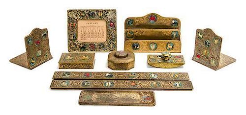 * A Tiffany Studios Enameled Dore Bronze Ten-Piece Desk Set, Width of first 19 1/2 inches.