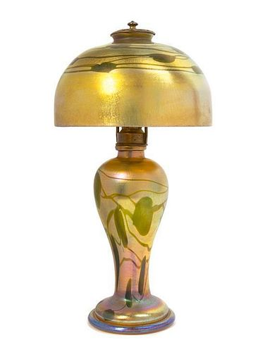 * A Tiffany Studios Gold Favrile Glass Lamp, Height overall 15 1/2 x diameter of shade 8 inches.