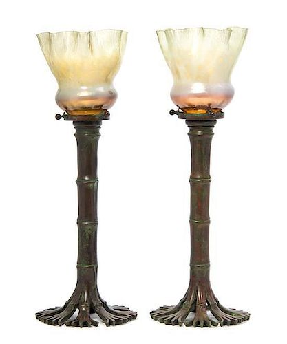 A Pair of Tiffany Studios Bronze Candlesticks, Height 14 5/8 inches.
