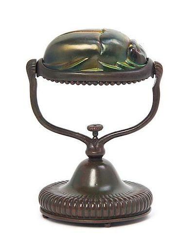 A Tiffany Studios Favrile Glass and Bronze Scarab Lamp, Height overall 8 1/4 inches.