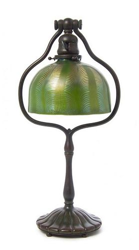 A Tiffany Studios Favrile Glass and Bronze Lamp, Height overall 18 1/8 x diameter of shade 7 1/8 inches.