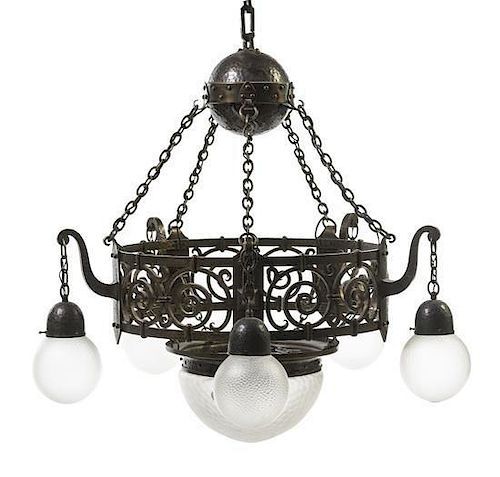 An Arts and Crafts Hammered Copper and Iron Chandelier, Diameter 34 inches.