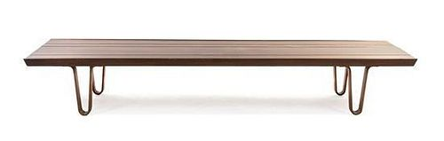 * An Edward Wormley Walnut Long John Low Table, for Dunbar, Height 11 1/2 x width 72 x depth 19 inches.
